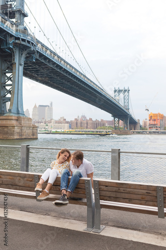 Young Goofy Couple Being Funny sitting on a Bench in Brooklyn Poster
