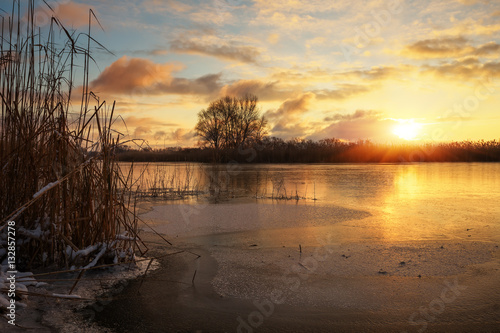 Poster Marron chocolat Winter landscape with sunset sky and frozen river. Daybreak