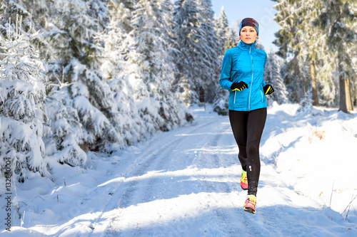 Garden Poster Winter sports running in the wintry forest