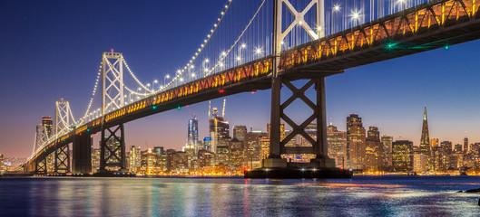 Fototapeta Mosty San Francisco skyline with Oakland Bay Bridge at night, California, USA