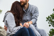 Close up, couple in love sitting on a mountain, hugging and look