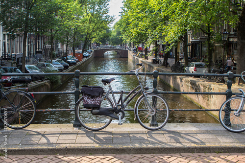 Photo  Amsterdam canal scene with bicycles and bridges