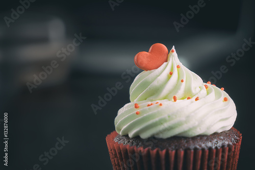 фотография  Chocolate Cupcake topped with red heart candy for valentine.