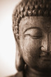 Face of Buddha, This is a close-up photograph of an antique wood carving of a sculpture of Buddha