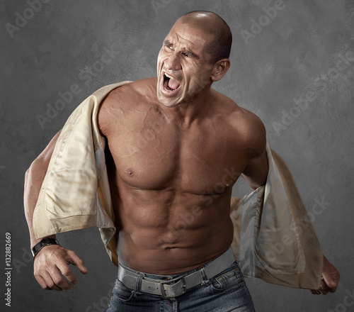 funny portrait of crying angry bully man buy this stock photo and