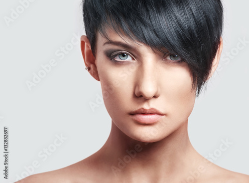 Beautiful young woman with short hairstyle