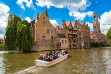 Canal In Bruges And Belfry Tower