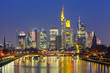 Picturesque view of business district with skyscrapers and mirror reflections in the river during morning blue hour, Frankfurt am Main, Germany