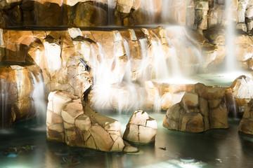 Fototapeta na wymiar Fountain is in Las Vegas. Night city landscape with waterfall.