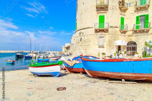 Foto auf Gartenposter Stadt am Wasser Fishing boats in small port Giovinazzo near Bari, Apulia, Italy