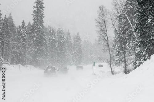 Photo Line of trucks driving in a Colorado blizzard