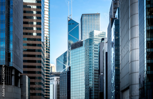Papiers peints Batiment Urbain Commercial buildings stretch up to the sky in Hong Kong