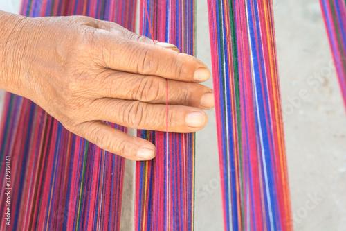 Fotografie, Obraz  Weaving in local style
