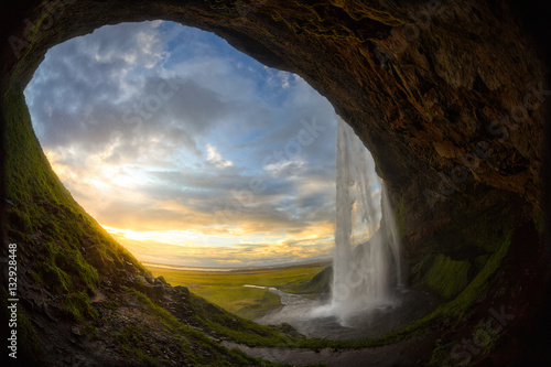 Scenic view of waterfall during sunset - 132928448