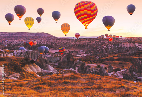 Scenic vibrant view of balloons flight in Cappadocia valley in s