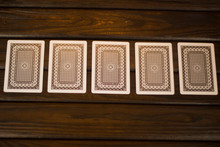 Playing Cards For Poker The Reverse Side Up On A Dark Wooden Bac