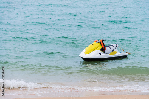 Poster Nautique motorise yellow and white Jet ski floating on blue sea,Tropical Ocean, pa