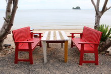 Red Wooden Table And Chairs On...
