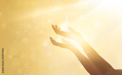 Cuadros en Lienzo Woman hands praying for blessing from god on sunset background