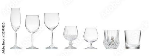 Foto op Canvas Alcohol Variety of empty glasses on white background