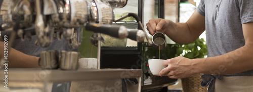 Fotografie, Obraz  Man preparing coffee