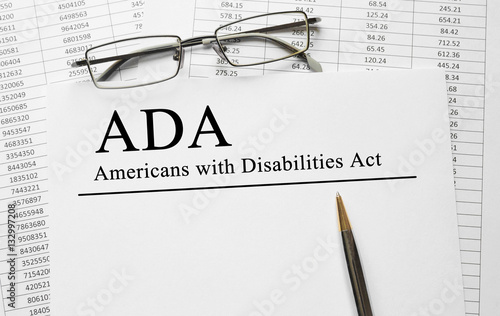 Paper with Americans with Disabilities Act (ADA) on a table Canvas Print