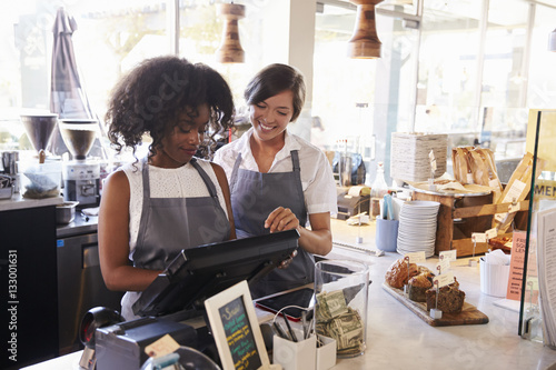 Fotografía  New Employee Receives Training At Delicatessen Checkout