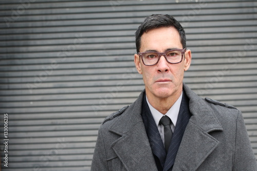 Foto  Stern looking businessman close up with copy space
