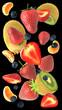 Cascata di frutta su sfondo nero