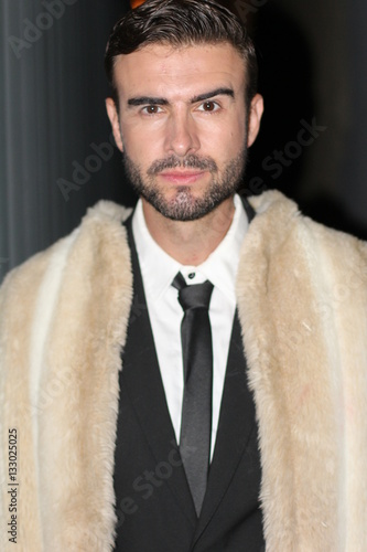 Fotografering  Sullen man in fur coat, suit and tie