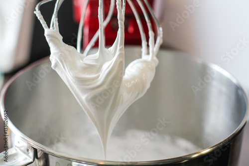 Obraz na plátně  Big mixing Whisk full of white cream