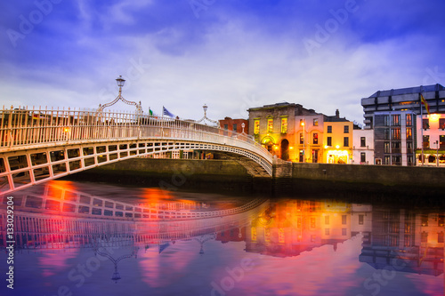 Ha'penny Bridge of the River Liffey in Dublin Ireland in the evening with lights Canvas Print