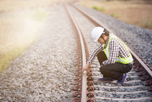 Railroad Workers Checking Rail...