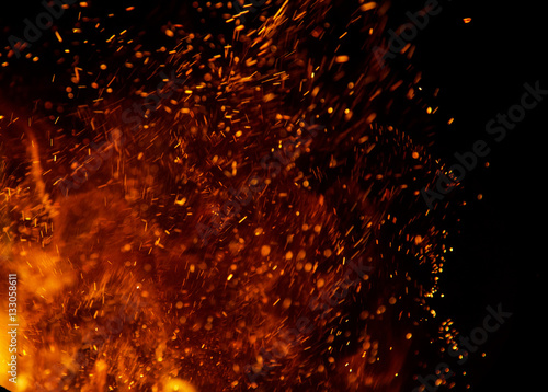 Poster Fire / Flame fire flames with sparks on a black background