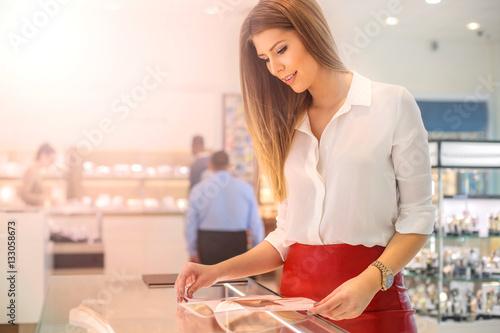 Photo  Looking at the catalogue