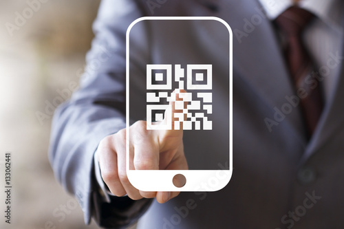 Fotografie, Obraz  Businessman pressing button qr code on smartphone