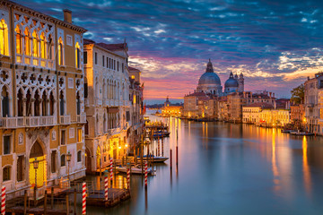 FototapetaVenice. Cityscape image of Grand Canal in Venice, with Santa Maria della Salute Basilica in the background.