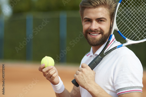 Tennis player while preparing for the game .