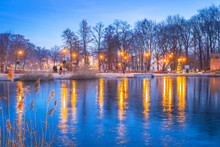 Winter Scenery Of The Park In Trzebnica With Frozen Pond, Poland
