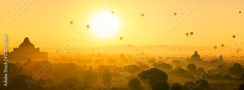 Fototapeta Hot air balloon over plain and pagoda of Bagan in misty morning obraz