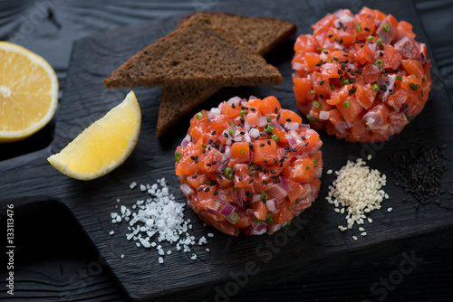 Close-up of fresh salmon tartar topped with black sesame seeds Canvas Print