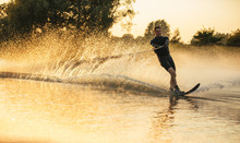 Man Riding Wakeboard In A Lake