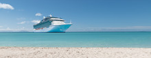 Summer Vacation Concept: Cruise Ship In Caribbean Sea Close To Tropical Beach.