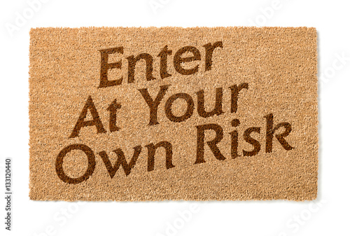Photo Enter At Your Own Risk Welcome Mat Isolated On A White Background