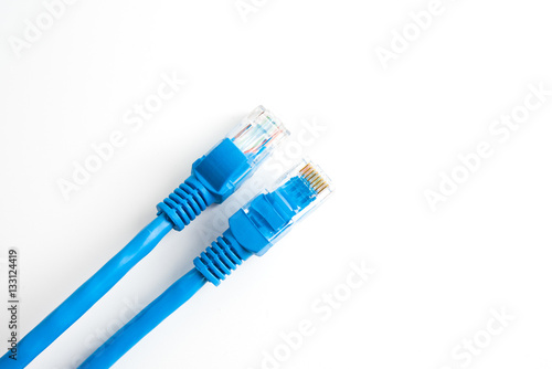 network UTP cable with RJ45 connector isolated on white Canvas Print