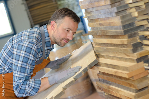 Craftsman holding wood