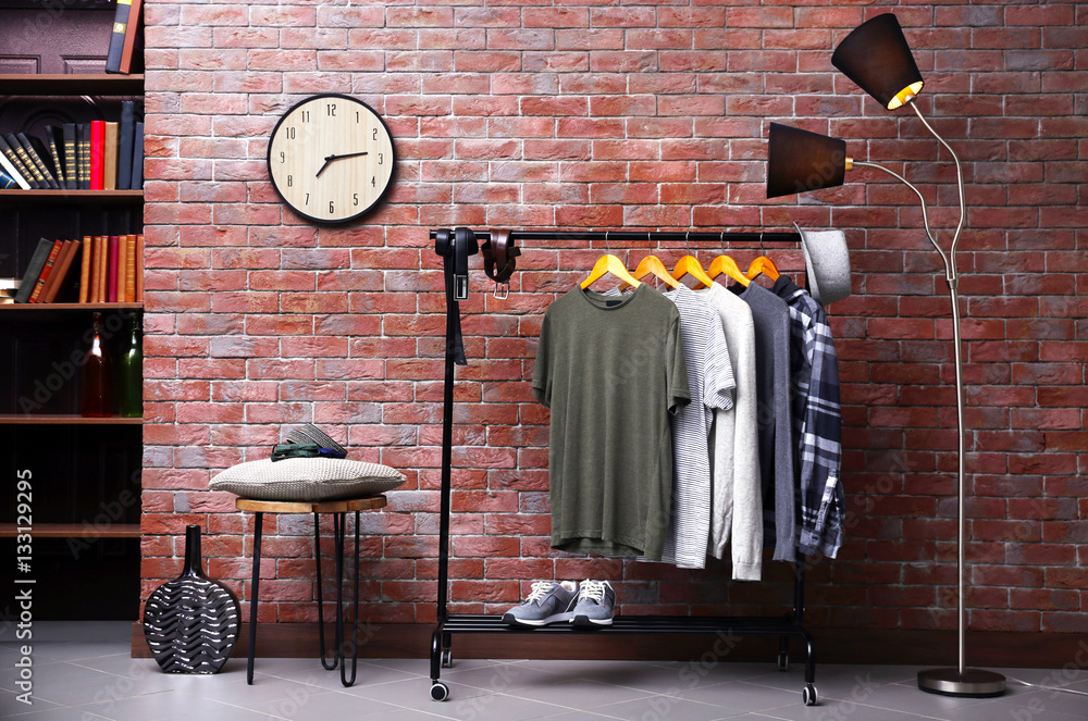 Fototapety, obrazy: Casual stylish shirts on hanger stand in room