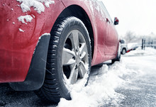 Close Up View Of Car On Road In Winter Day