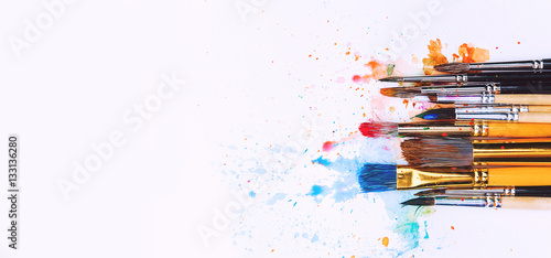 artistic brushes on wooden background Canvas Print