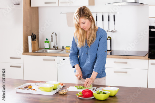 Poster Cuisine Woman Cutting Vegetable On Chopping Board